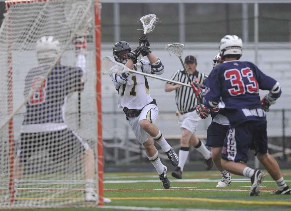 Sachem North's Dalton Crossan shoots and scores on