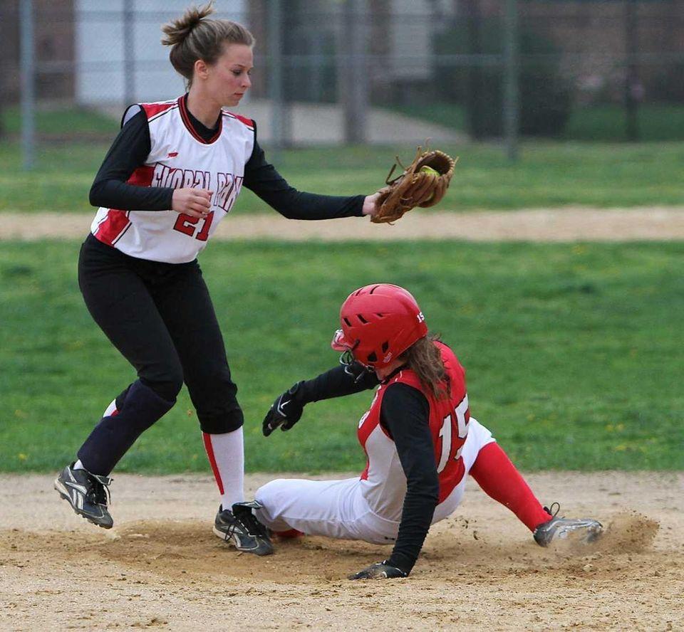 Floral Park shortstop Christine Hand #21 applies the