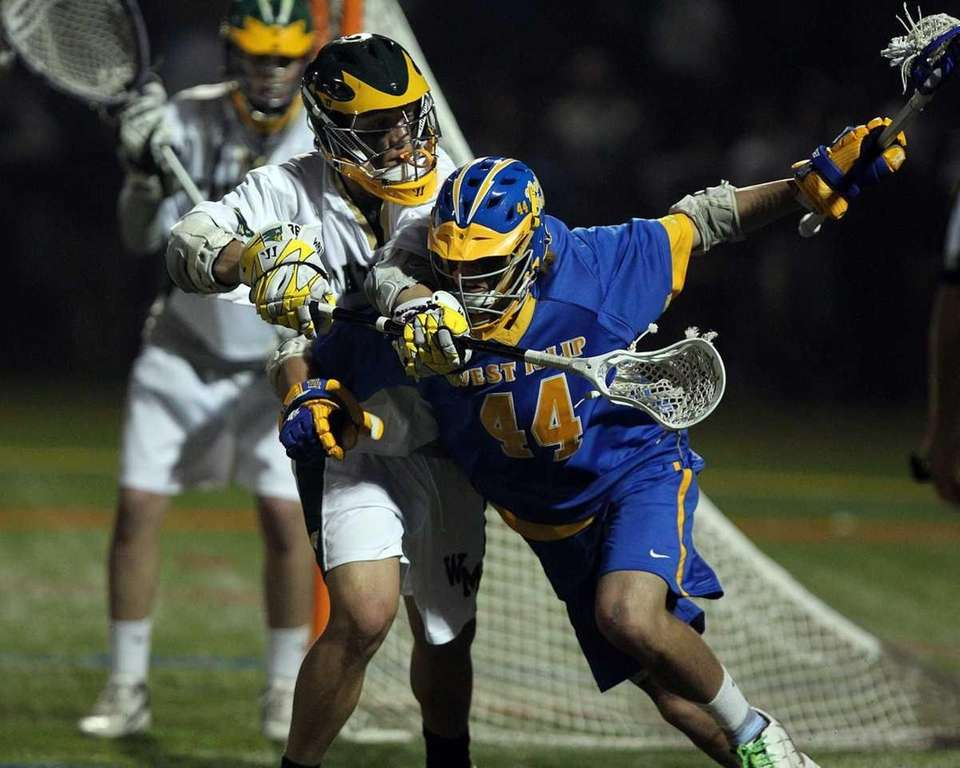 West Islip's Michael Diggle (44) is marked by