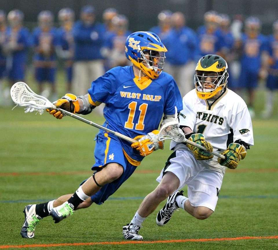 West Islip's Nick Apponte (11) drives against Ward