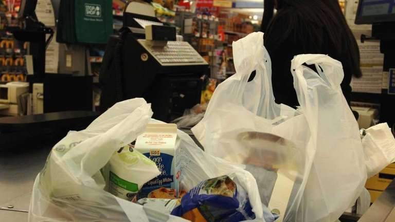 Plastic bags on a checkout counter at a