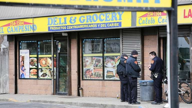 Police investigate the shooting at El Campesino Deli