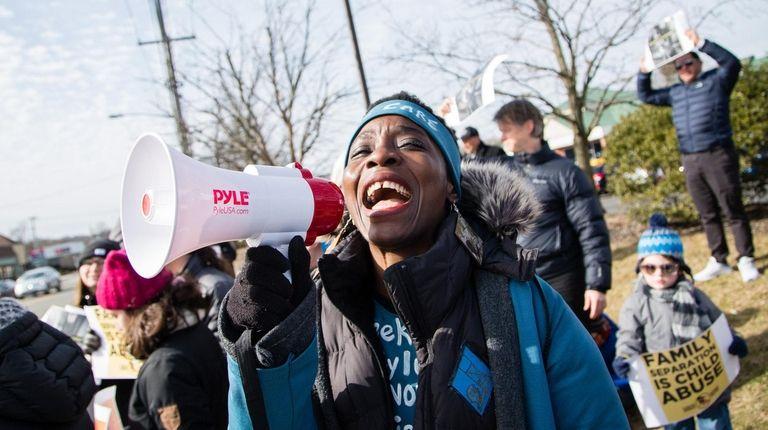 Patricia Okoumou speaks at a rally in Huntington