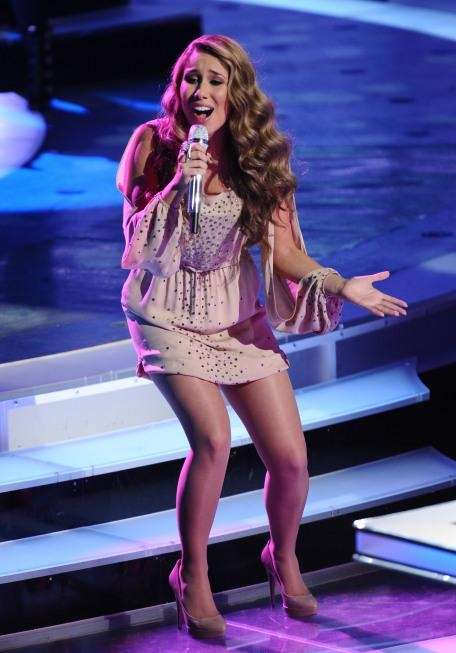 Haley Reinhart, dressed in a taupe slit sleeved