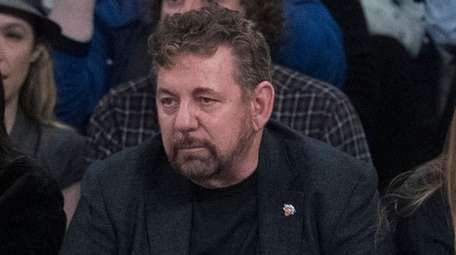 Madison Square Garden chairman James Dolan, center, watches