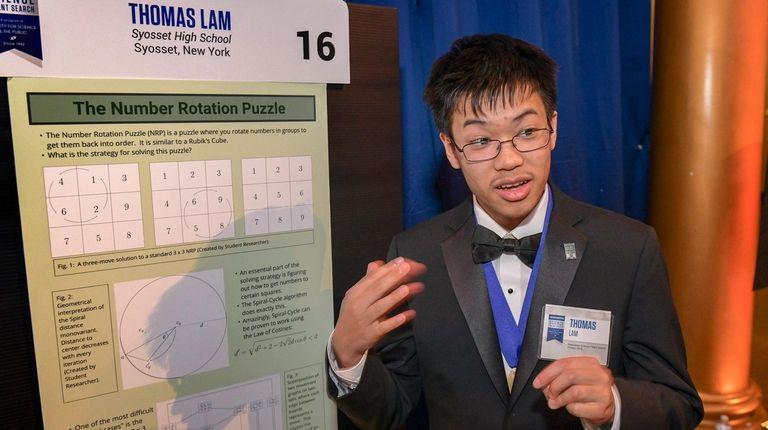 Thomas Lam, 17, of Syosset High School, chats