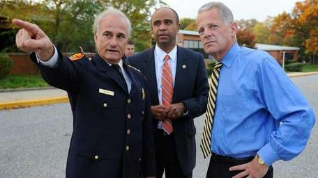Suffolk County Police Chief Bob Moore, left, points