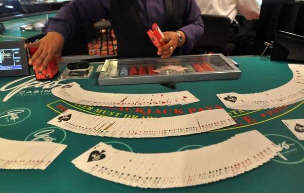A blackjack dealer works on the Escapade, a