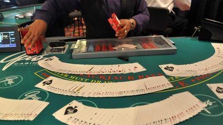 A blackjack dealer works on the Escapade, a