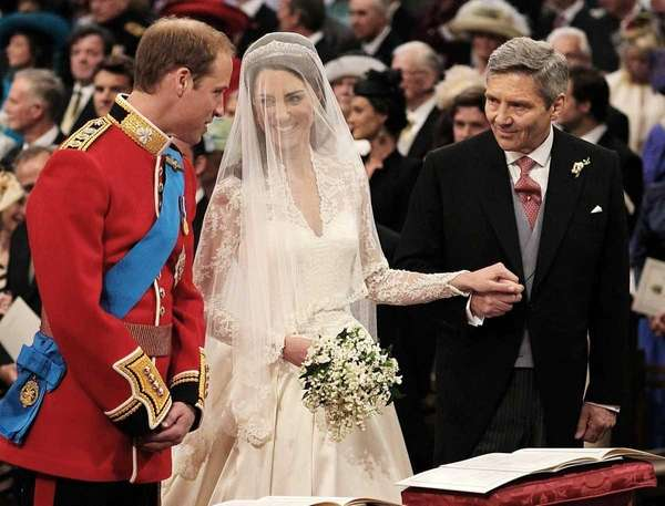 Prince William greets Kate Middleton as she arrives