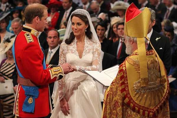 Britain's Prince William and Kate Middleton exchange rings
