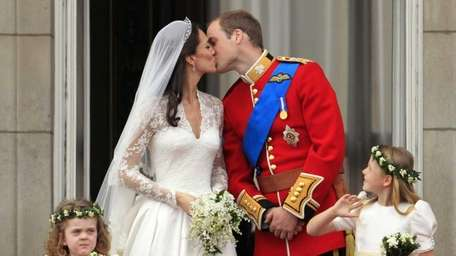 Britain's Prince William kisses his wife Kate, Duchess