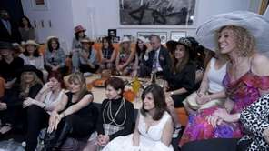 Women gather at an early-morning royal wedding party