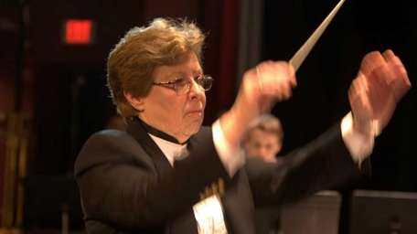 Helen Bauer conducts the Northwinds Symphonic Band, which