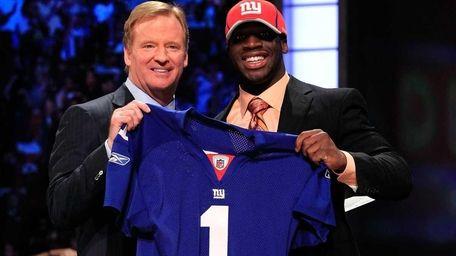 NFL Commissioner Roger Goodell, left, poses for a