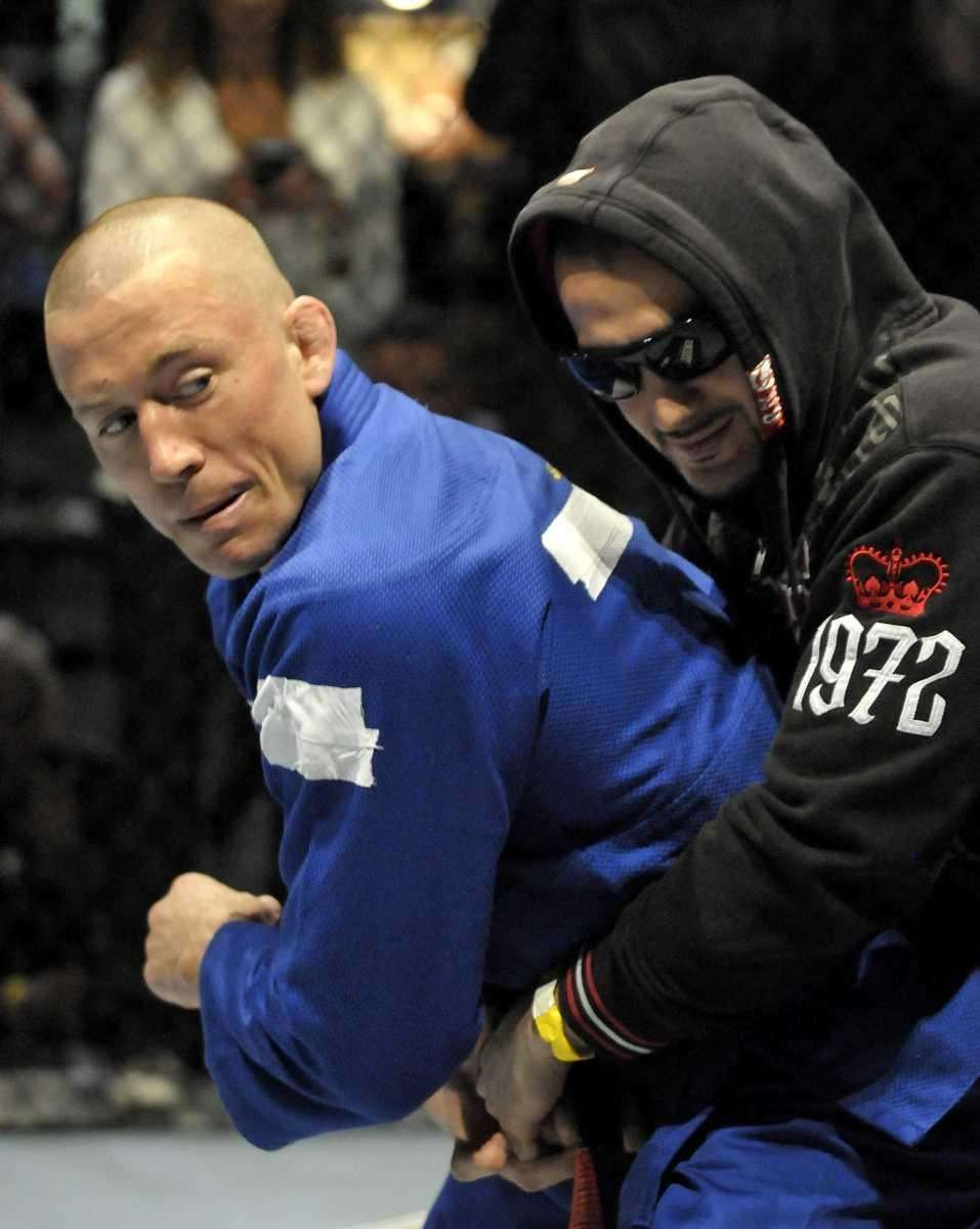 Georges St-Pierre,left, thwarts a simulated attack while working