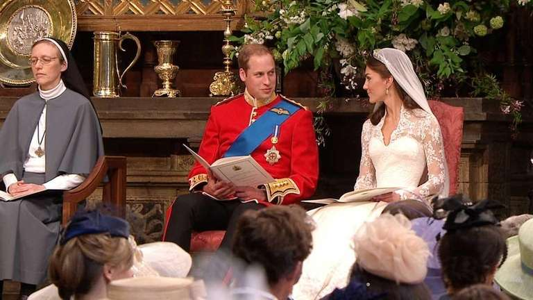 Britain's Prince William, center, looks at his wife,