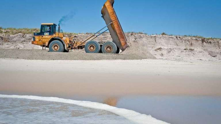 Private construction contractors bring sand to Robert Moses