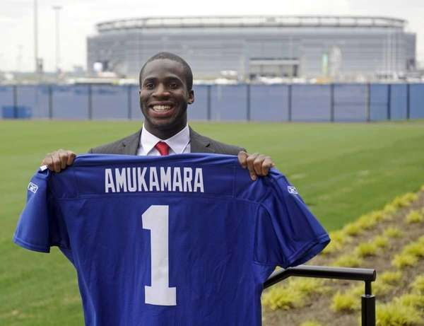 Giants first-round draft pick Prince Amukamara holds up