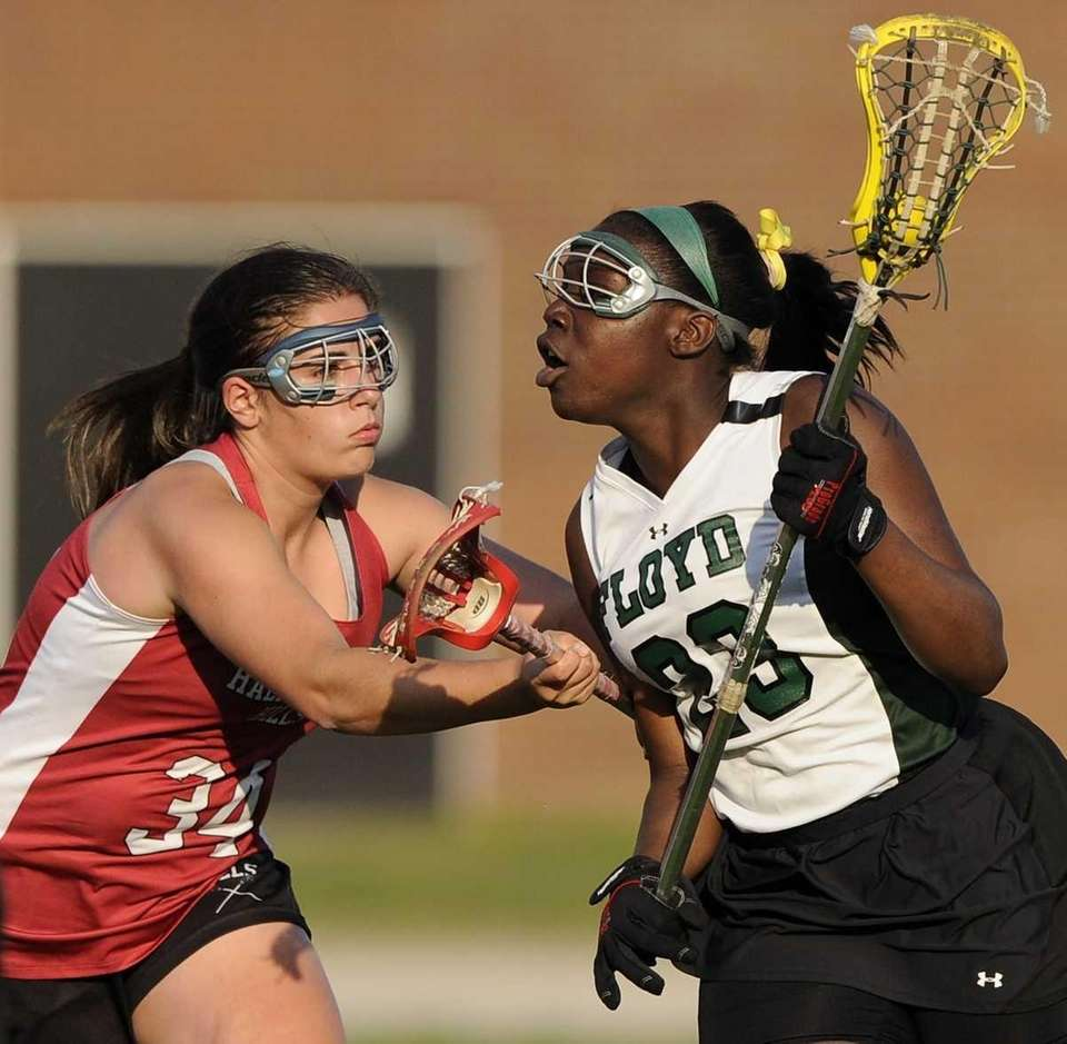 William Floyd's Monique Walker controls the ball as