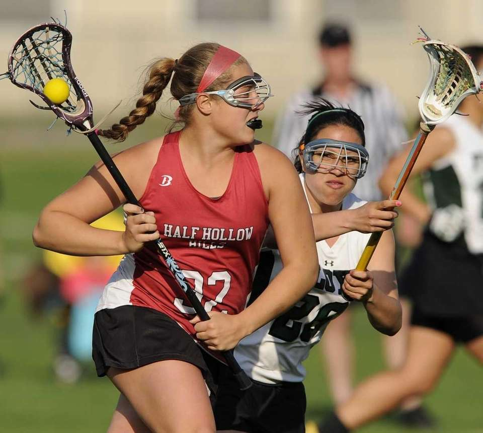 Half Hollow Hills attacker Alexis Maffucci is defended