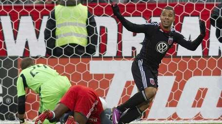 DC United's Charlie Davies, right, celebrates scoring a