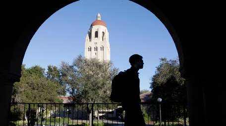 A Stanford University student walks in front of