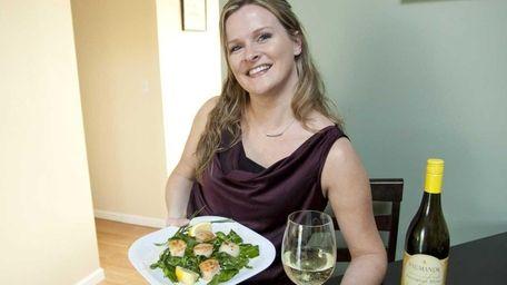 Karen Kankel displays her scallop dish, prepared with