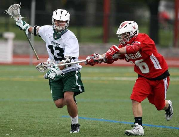 Farmingdale's Jimmy Owsinski plays keep away with Montclair's