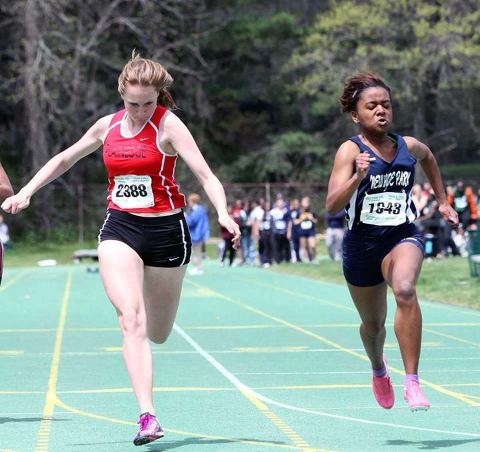 New Hyde Park's Neigelle Francisco (right) edges out
