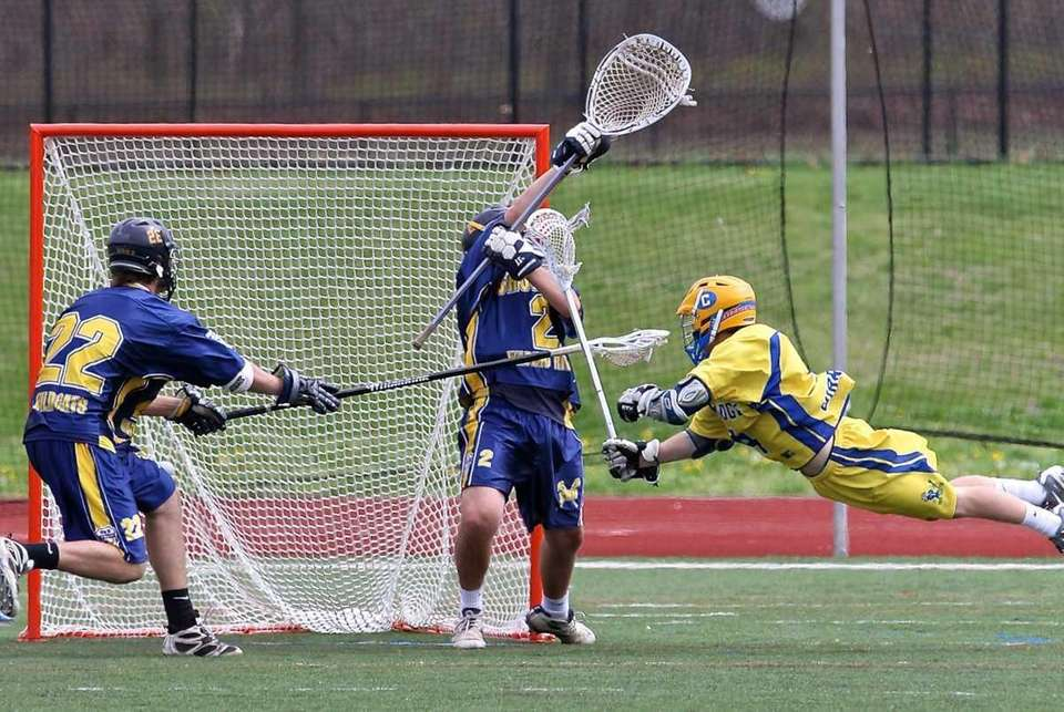 Comsewogue Russell Conor #4 scores a diving goal