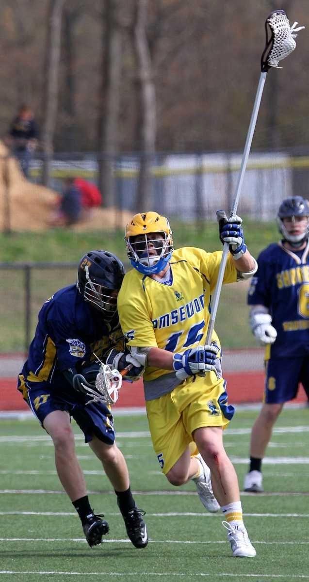 Comsewogue defenseman Matt Welsch #15 moves the ball