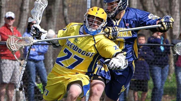 Comsewogue midfield Connor Duddy #27 breaks for the