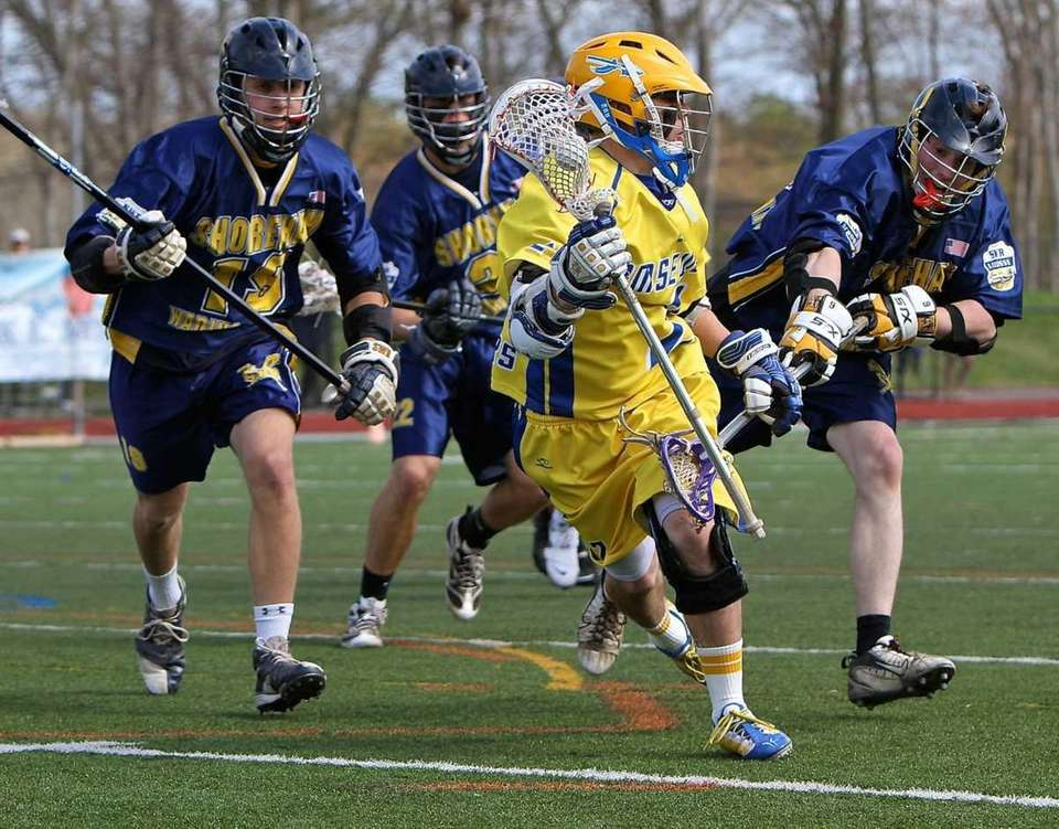Comsewogue attack Kevin Drane #2 looks for the