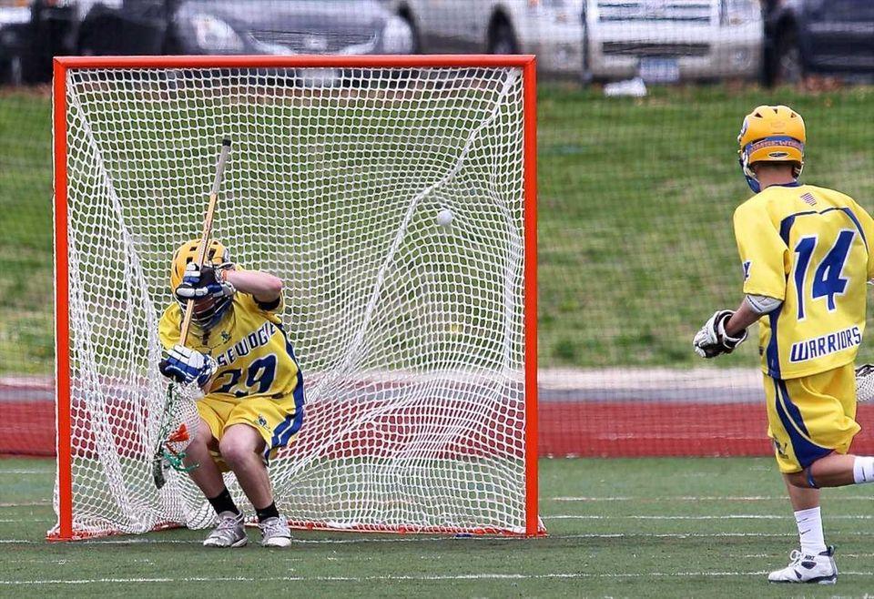 Comsewogue goalie Pat Bonacum #39 can't stop this
