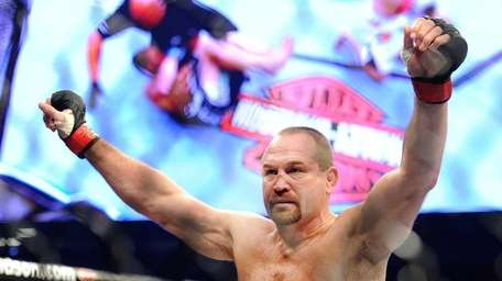 Vladimir Matyushenko celebrates after knocking out Jason Brilz