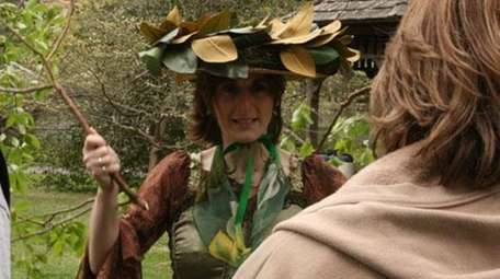 Dressed as a tree, Michele Krause, 41, of