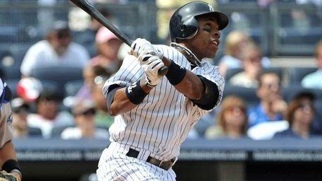 New York Yankees center fielder Curtis Granderson (14)