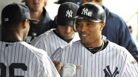 Robinson Cano is greeted in the dugout third