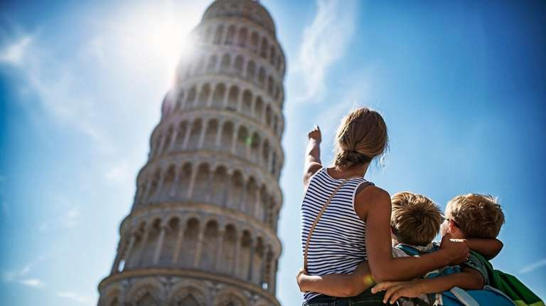 A family takes in the Leaning Tower of