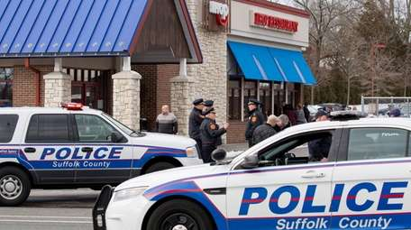 Suffolk County police investigate at the IHOP on