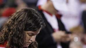 Fans check their cell phones during a baseball