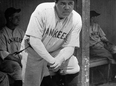 Babe Ruth in the Yankees' dugout during a