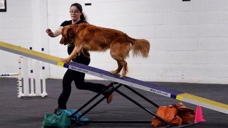 Amanda Muller of Mastic with her dog Paisley