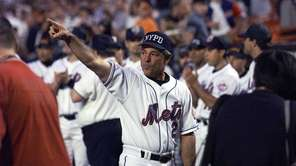 Bobby Valentine waves to the crowd after the