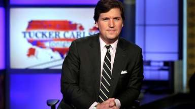 "Tucker Carlson, host of ""Tucker Carlson Tonight,"" poses"