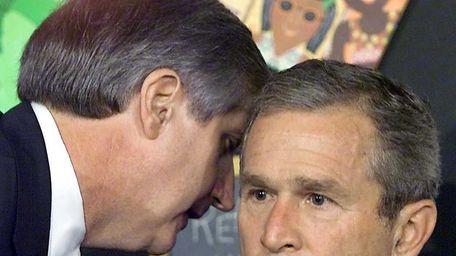 Former U.S. President George W. Bush having his