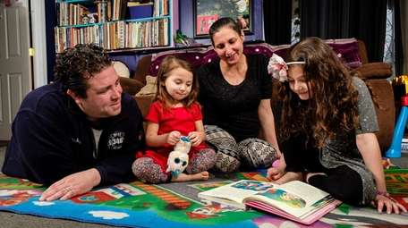 James and Jennifer Borzumato read stories together with