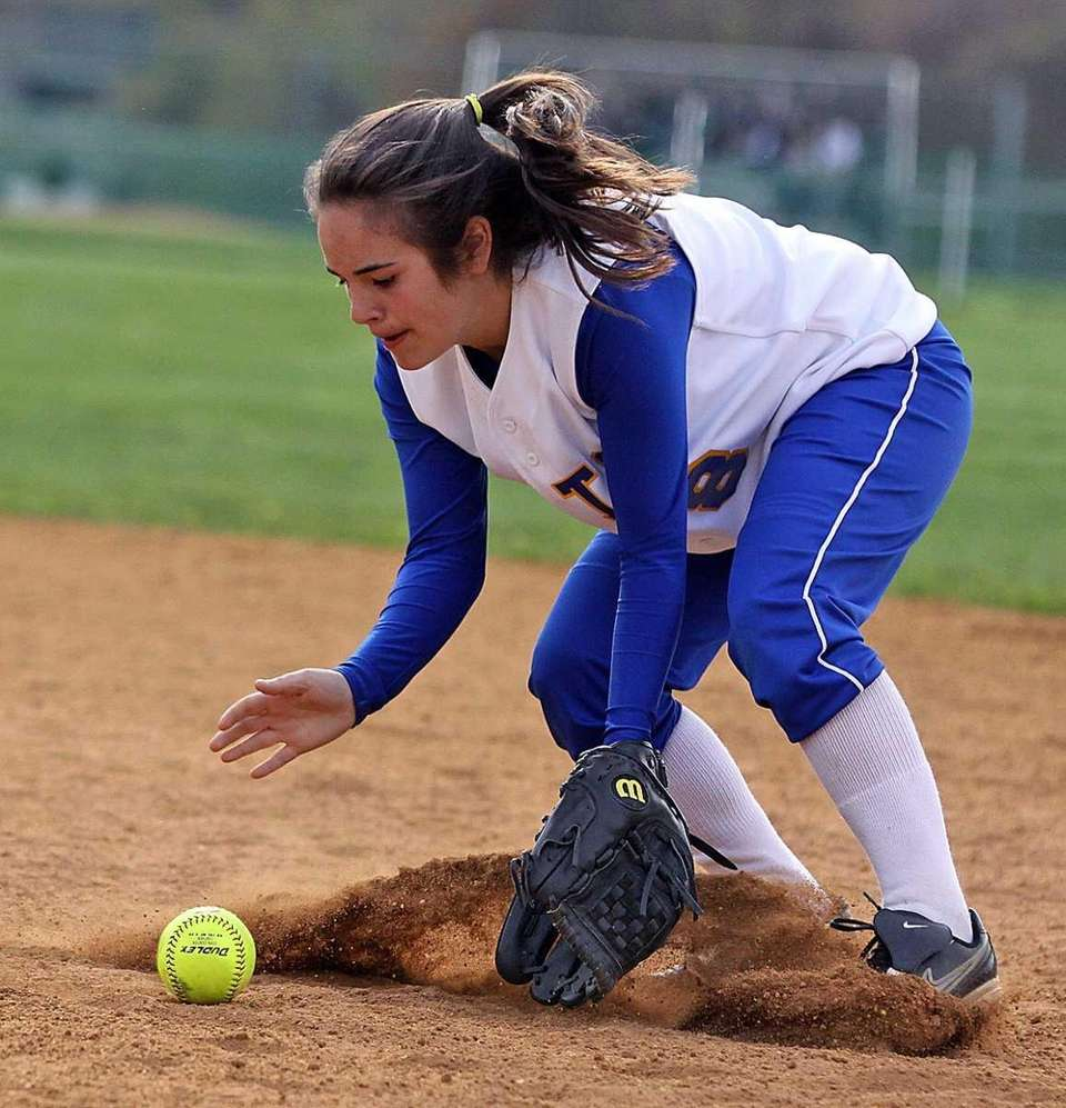 East Meadow's Nikki Giocastro scoops up the ball
