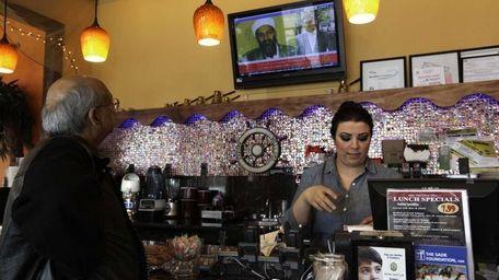 Tamara Halees, right, manager at Assayad Restaurant prepares